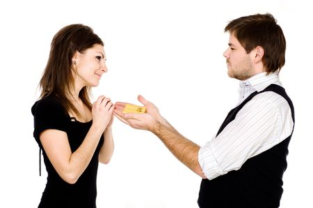 A man holding out a box with a wedding ring to a pleasantly surprised and pleased woman photo