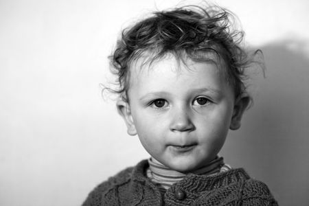 assume: Assuming  airs little boy  with dishevelled hair before the camera
