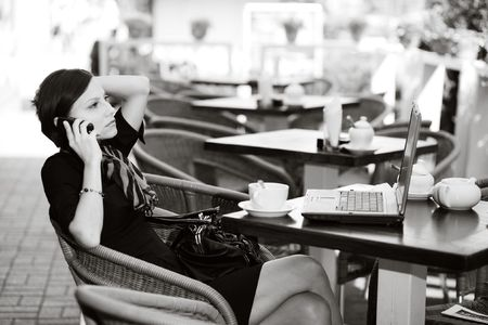 An image of a young woman in a small caffe photo