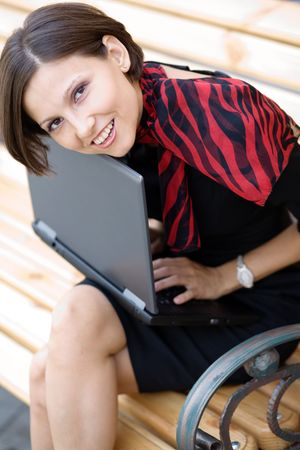 An image of a young woman with a laptop Stock Photo - 5411364