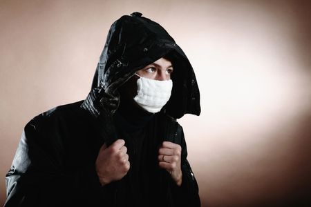 protective mask: A young man with a protective mask on brown background Stock Photo