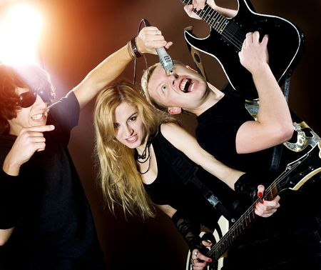 Rock singer with his band during in studio. Stock Photo