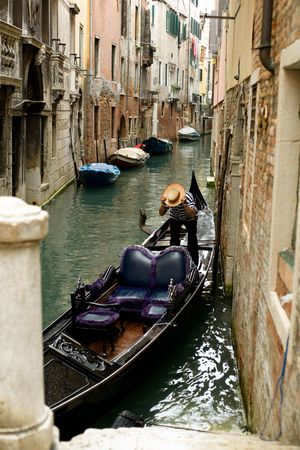 An image of a gondola  in a narrow canal photo
