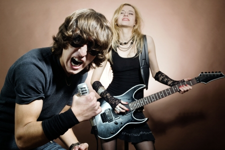 Rock band:  man and woman during concert. Stock Photo - 5857180