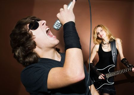 Rock singer and woman with guitar during concert. Stock Photo - 5857196