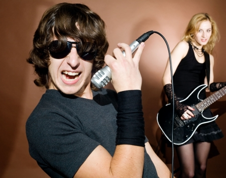 Rock singer with woman during in studio. photo