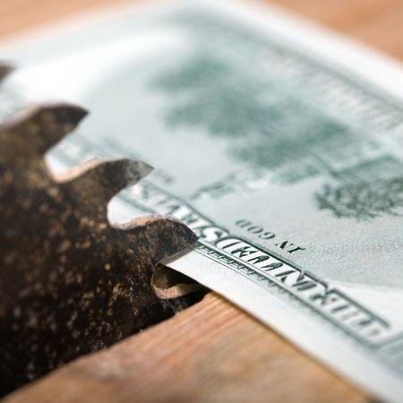 An image of dollar and circular saw photo