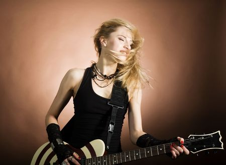 An image of a nice girl with guitar photo