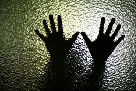 An image of a silhouette of small hands photo