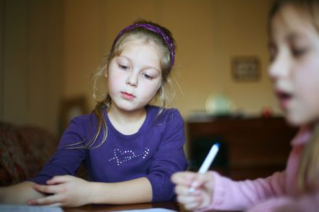 An image of two little girls doing homework photo