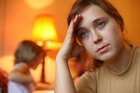 An image of a tired woman and a child Stock Photo