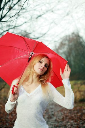 A woman with a red umbrella in the park photo