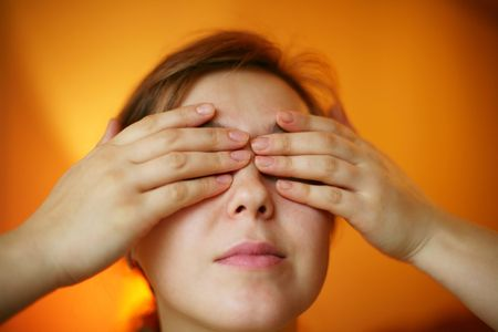 A woman with her hands on her face photo