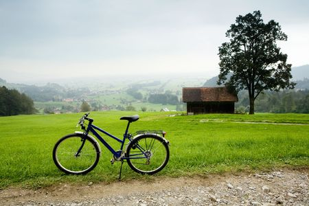 An image of bike near road in montains photo