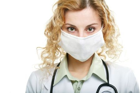 grippe: An image of a young doctor in mask Stock Photo