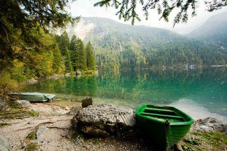 green boat: An image of a green boat at beautiful lake