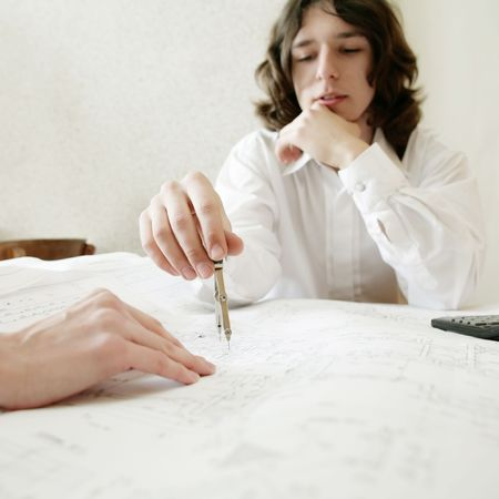 An image of a young architect, focus on a hand photo