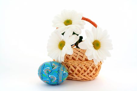 Three flowers in a basket and an egg photo