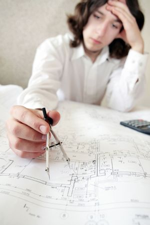 An image of an architect, focus on a hand photo