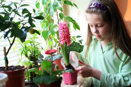 An image of a girl taking care of her flowers photo