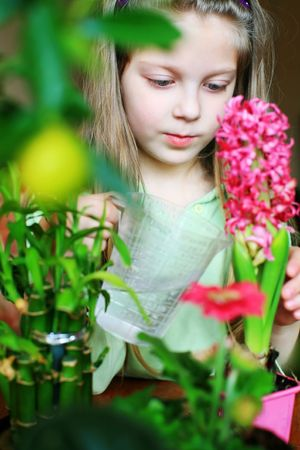 An image of a nice girl watering her flowers photo