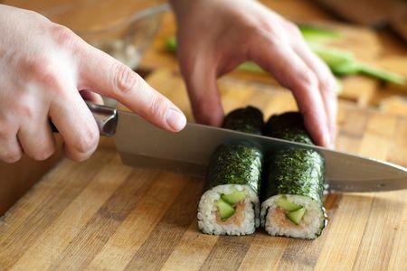 An image of a man cutting a roll