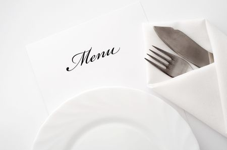 An image of a plate, knife and fork photo