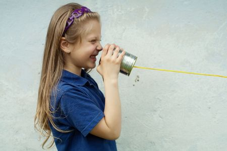 An image of a nice little girl with a toy-telephone photo