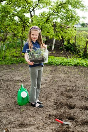 An image of a nice little girl in the garden photo