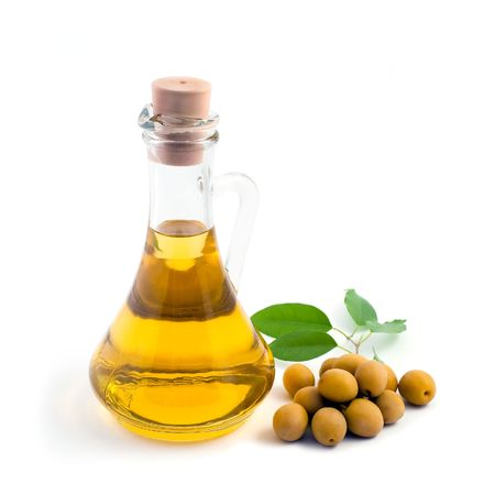 Green olives and bottle of oil on the table Stock Photo