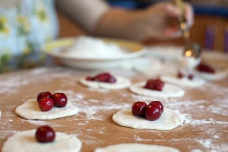 An image of raw dumplings with fresh cherries Stock Photo - 7284824