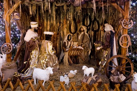 Christmas nativity scene with three Wise Men presenting gifts to baby Jesus, Mary & Joseph photo