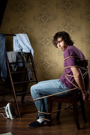 An image of a young man on a chair photo