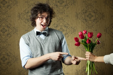 An image of a young man in big glasses and flowers Stock Photo - 8271444