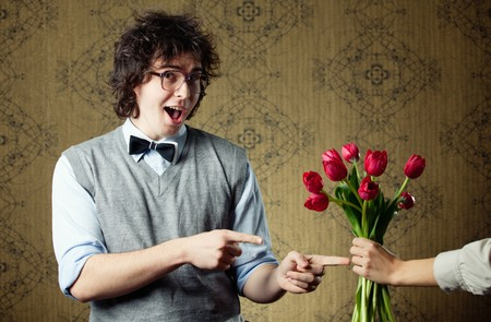 An image of a young man in big glasses and flowers Stock Photo - 8271437