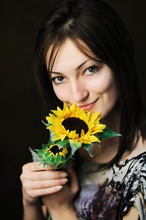 An image of a beautiful woman with sunflower  photo
