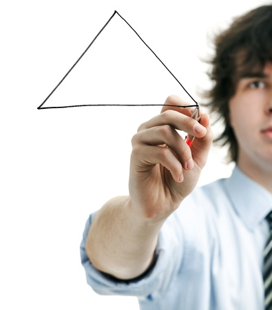 Young manager draws a triangle in the air  photo