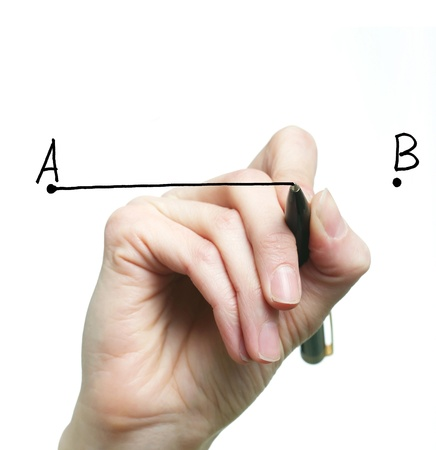 An image of a hand drawing a line