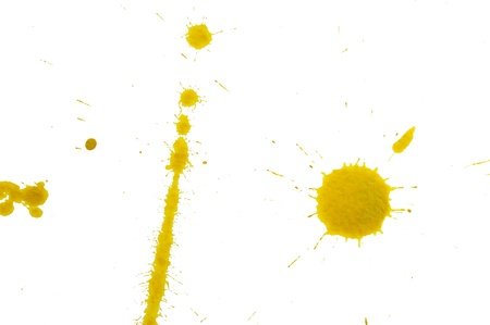 An image of yellow spots on white paper photo