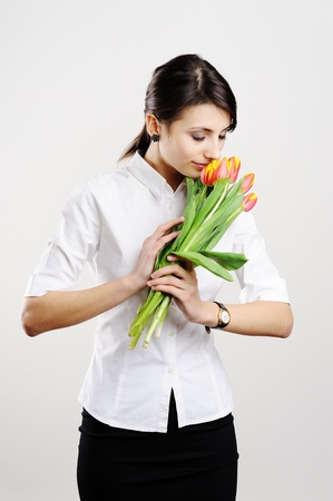 An image of young businesswoman with tulips Stock Photo - 8761617