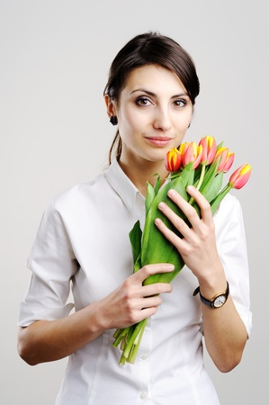 An image of young businesswoman with tulip Stock Photo - 8761620