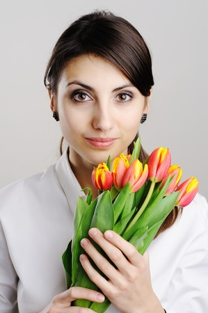 An image of young girl with tulip Stock Photo - 8761628