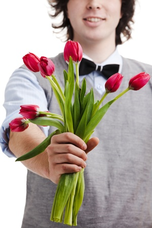 A young boy with a bouquet of red tulips photo