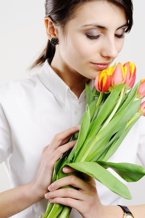 An image of young girl with fresh tulips Stock Photo - 8761625