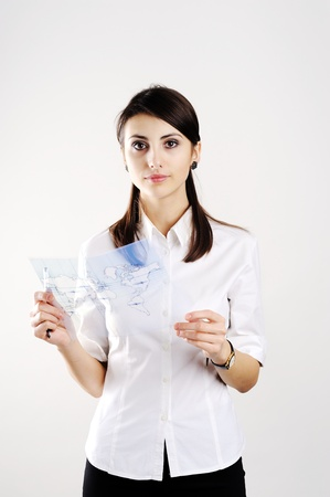 A girl with the map of the world printed on a transparent material Stock Photo - 8761792