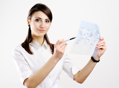 A girl holding a map of the world printed on a transparent material Stock Photo - 8761778