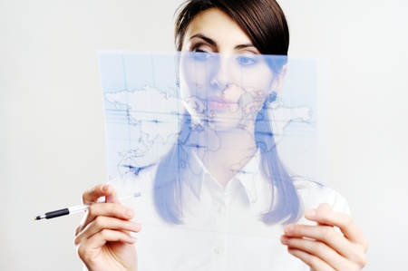 A girl holding a map printed on a transparent material Stock Photo - 8761872