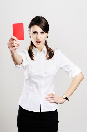 An image of young beautiful woman showing red card photo