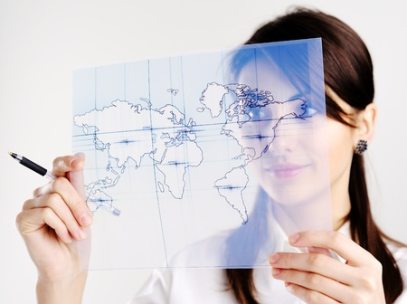 The girl with the map of the world printed on a transparent material Stock Photo - 8761856