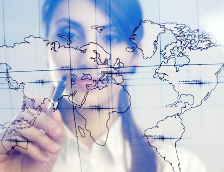 A girl with a map printed on a transparent material Stock Photo - 8761915